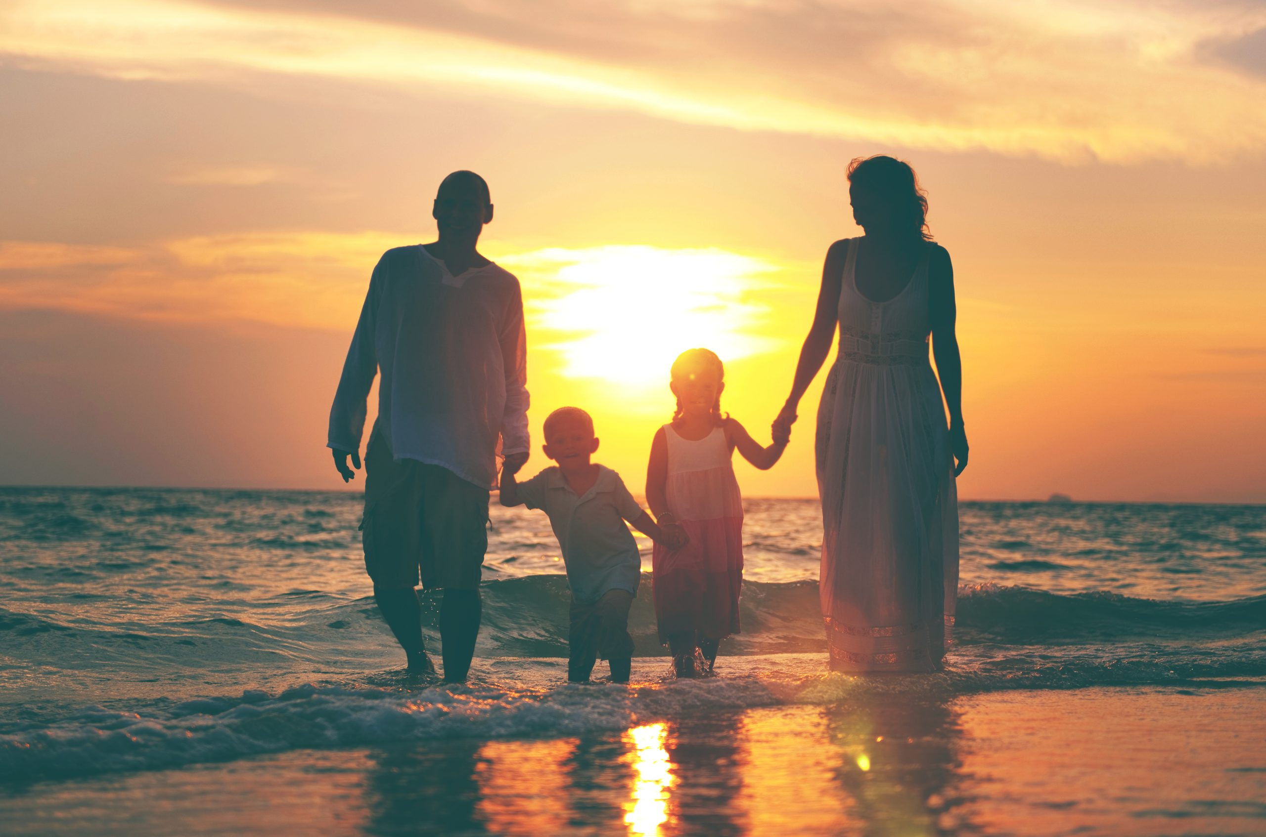 family having fun vacation with perfect sunset scaled