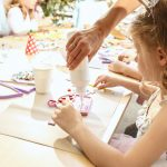 mosaic puzzle art for kids, children's creative game. two sisters are playing mosaic