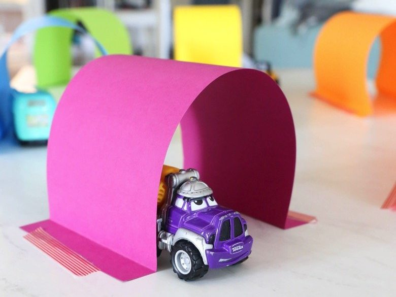 Pink paper tunnel with a toy truck