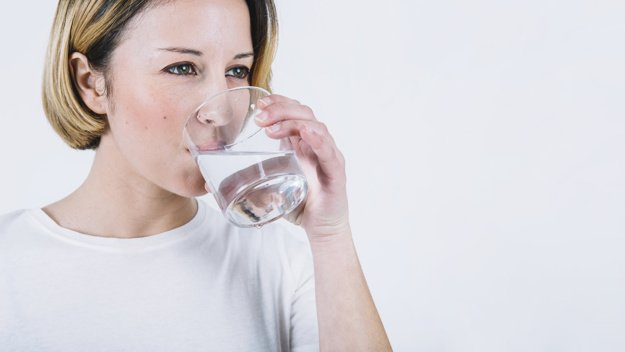 lovely woman drinking water white background 23 2147765120