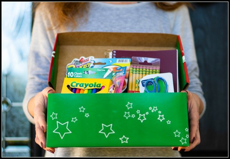 a box with different school supplies