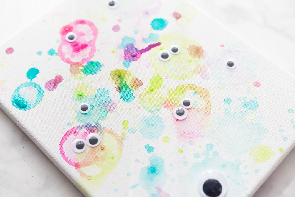 bubble-painted monsters on a canvas
