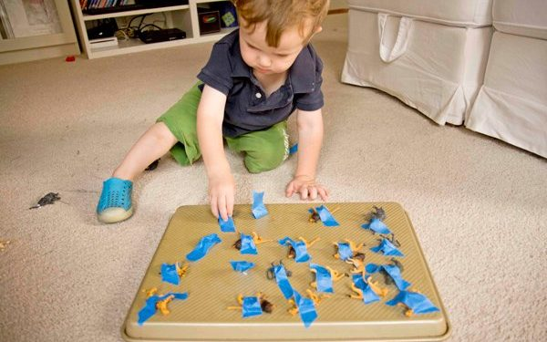 kid playing animal tape rescue activity