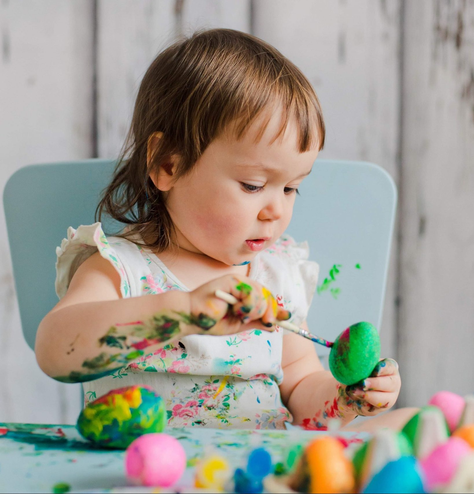 lily-baby-painting-easter-eggs-eden-profile