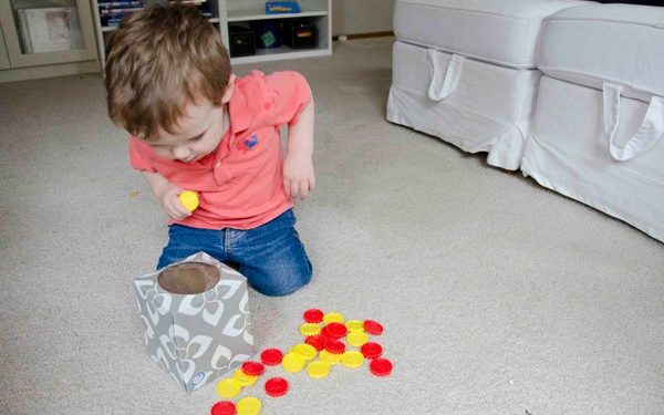 kid playing drop box taby activity