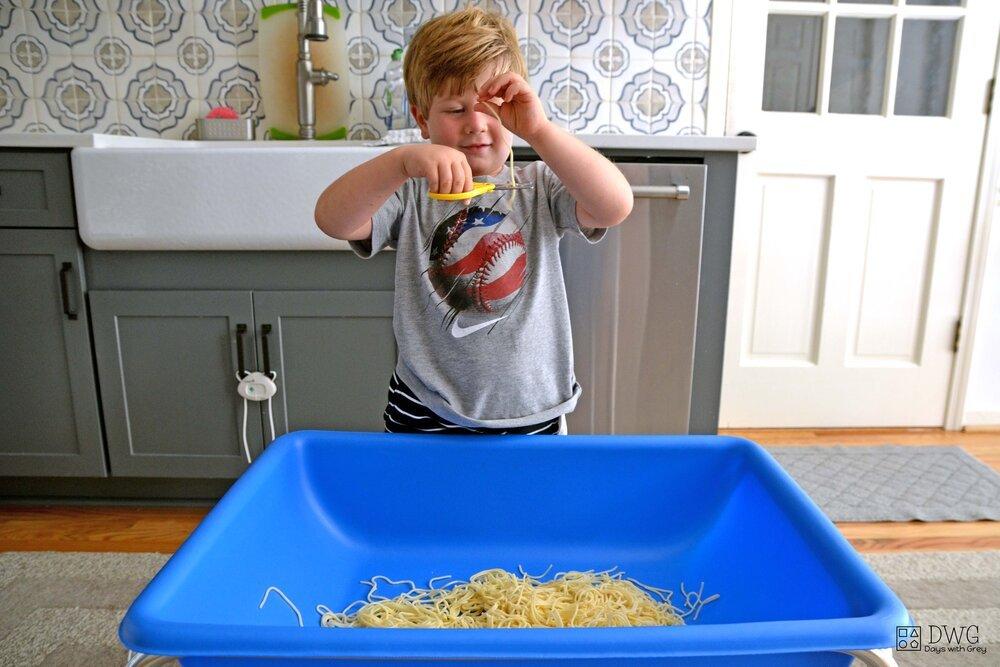 Kid cutting spaghetti