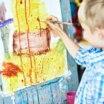 Little Boy Painting in Art Therapy