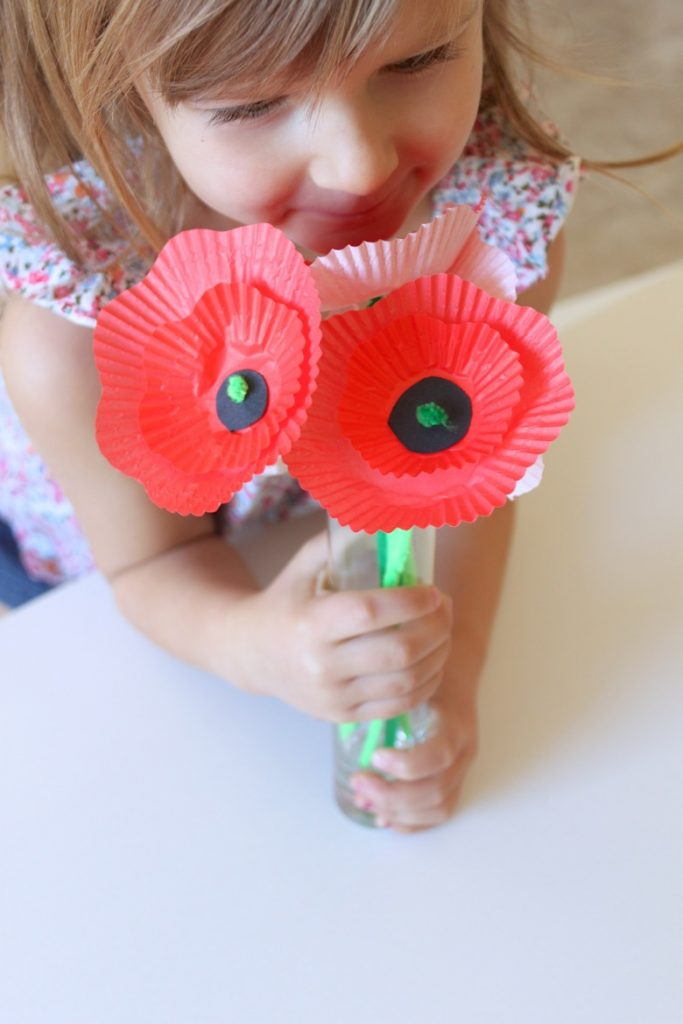 Girl holding a Cupcake-Liner Poppy Bouquet
