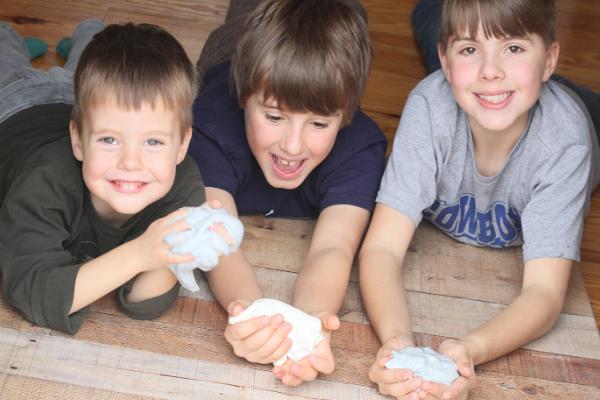 Kids holding flubber